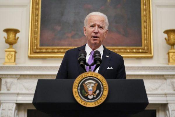 Biden signs burst of virus orders, vows 'Help is on the way'